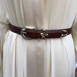 Leather belt with silver tone buckle